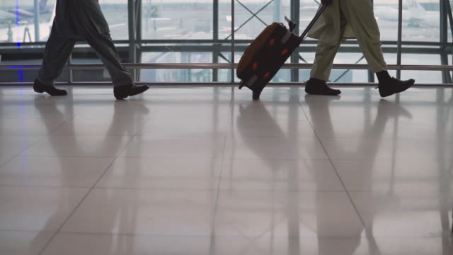 muslim business men with suitcase at airport - dish dash stock videos & royalty-free footage