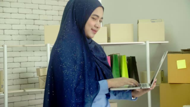 muslim business owners using computers and tablets - tailored clothing stock videos & royalty-free footage