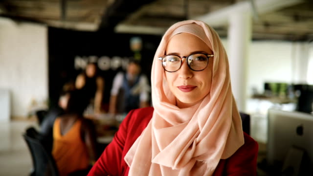 muslim business woman in a conference room - hijab stock videos & royalty-free footage