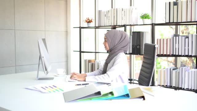 muslim business woman working in office. - saudi arabia stock videos & royalty-free footage