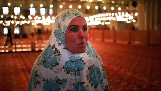vídeos de stock e filmes b-roll de muslim couple rehue calquin and sofia gonzalez from south american indian tribes mapuche in argentina visit istanbul turkey on february 11 2017 sofia... - ponto turístico