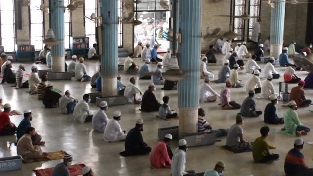 muslim devotees gather while maintaining social distancing protocols as they offer their prayers on the first friday of the holy month of ramadan as... - praying stock videos & royalty-free footage