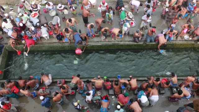 Muslim devotees perform ablution for prayer during 'Biswa Ijtema' the second largest religious gathering of Muslims in the world in Tongi 20 km from...