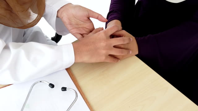 muslim doctor health care concept portrait two muslim hijab women doctor stethoscope on neck  and  female patient hospital clinic room  medical examination close up hand holding together - hijab stock videos & royalty-free footage
