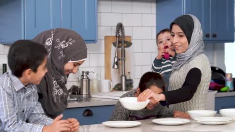 muslim family eating breakfast together - breakfast stock videos & royalty-free footage