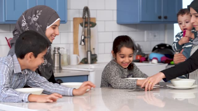 muslim family eating breakfast together - islam stock videos & royalty-free footage
