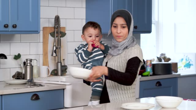muslim family eating breakfast together - kitchen stock videos & royalty-free footage