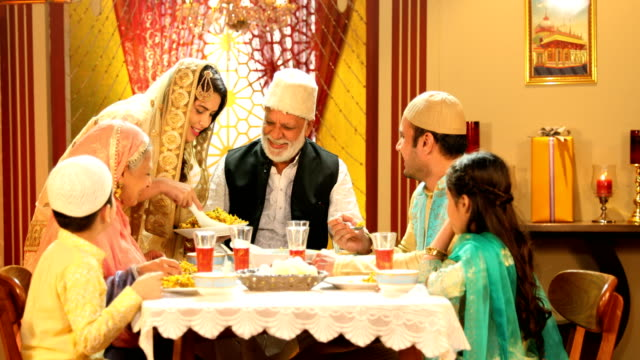 ms pan muslim family having biryani during ramadan / delhi, india - south asia stock videos & royalty-free footage