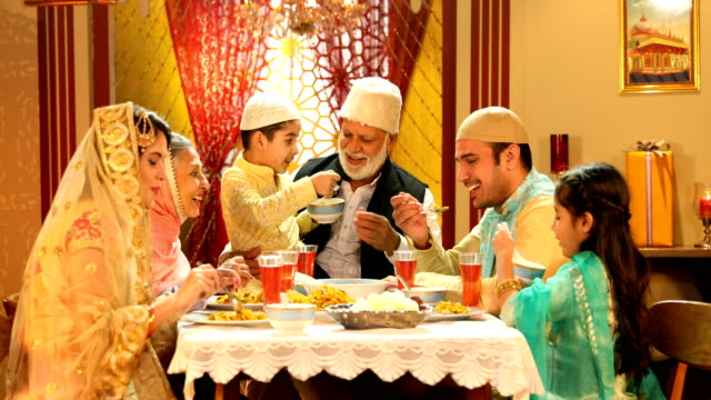 ms muslim family having food during ramadan / delhi, india - indiana video stock e b–roll