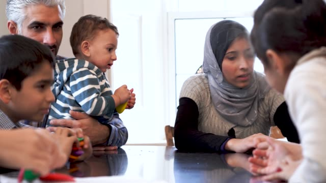 muslim family spending time together in their kitchen - middle eastern ethnicity stock videos & royalty-free footage
