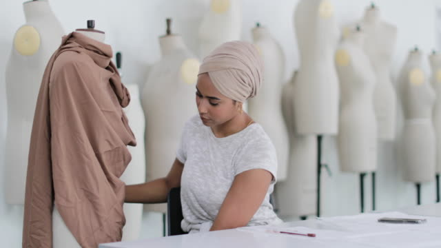 muslim female student fashion designer - expertise stock videos & royalty-free footage