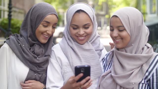 muslim girls checking social media - moroccan culture stock videos & royalty-free footage
