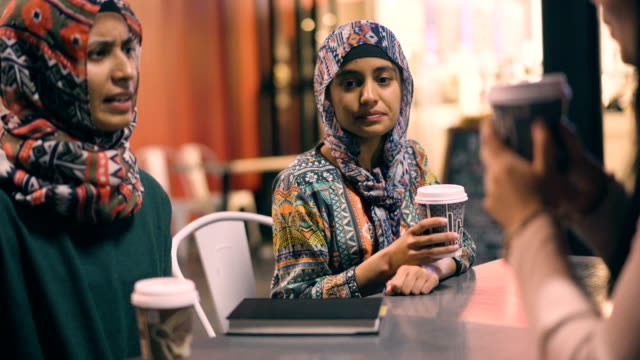 muslim girls having coffee. - auckland stock videos & royalty-free footage