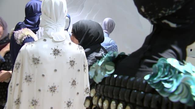 muslim headscarves start to appear at london fashion week; muslim women visiting hijab display at london fashion week ext ruqaiya haris interview sot... - 僧衣点の映像素材/bロール