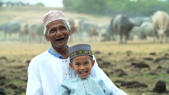 muslim lifestyle family people posing from grandfather and his nephew. - middle east stock videos & royalty-free footage