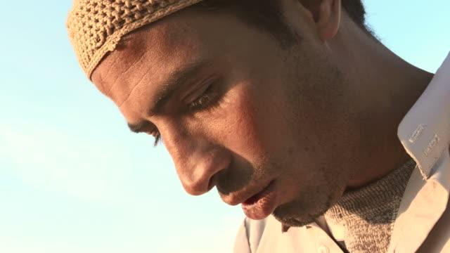 hd: muslim man at the end of salat - kufi stock videos & royalty-free footage