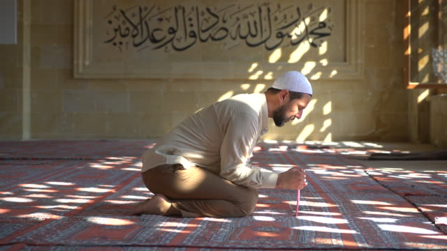 muslim man praying in mosque - religious celebration stock videos & royalty-free footage