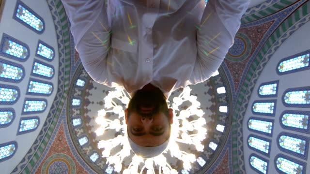 muslim man praying in mosque - pilgrim hat stock videos & royalty-free footage