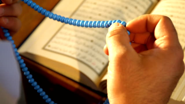 muslim man prays with a rosary - spirituality stock videos & royalty-free footage