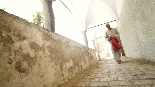 hd dolly: muslim man start reading the koran - praying stock videos & royalty-free footage