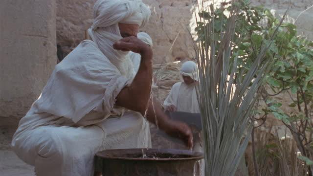 SLO MO MS RECREATION Muslim man washing arms during ritual purification ceremony / Iran