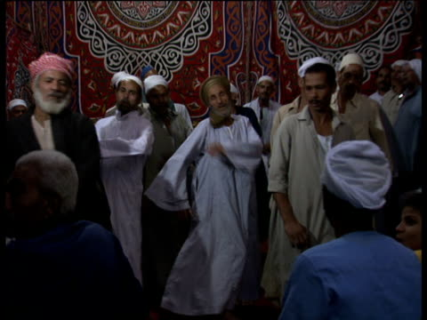 Muslim men perform religious dance to celebrate Mohammed's birthday Egypt