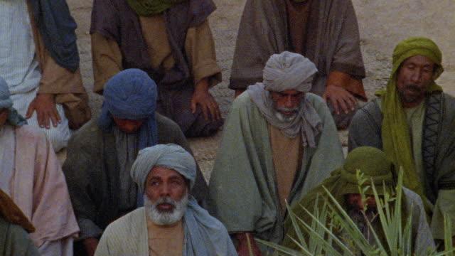 MS HA PAN RECREATION Muslim men praying in courtyard / Iran