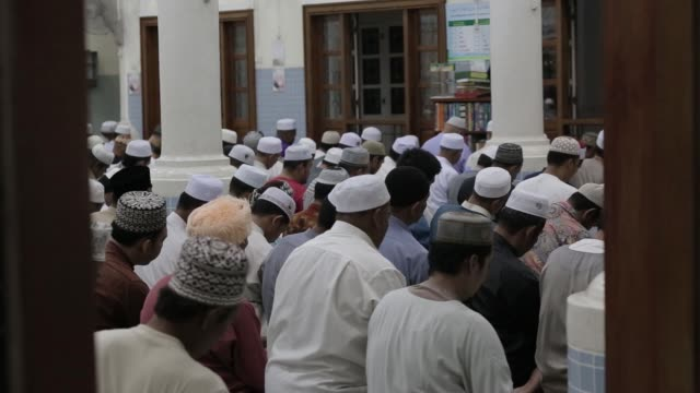 muslim men praying in mosque at ramadon night - praying stock videos & royalty-free footage