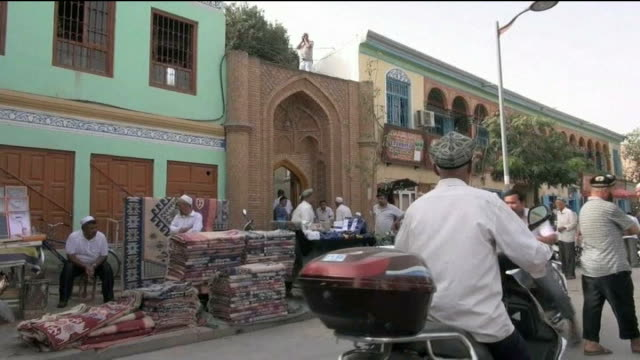 muslim minority group uighurs escape route from china china xinjiang province day city skyline statue of mao zedong various shots traffic along road... - mao stock videos and b-roll footage