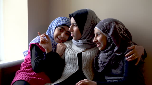 muslim mother and beautiful pre-teen daughters laughing together - islam stock videos & royalty-free footage