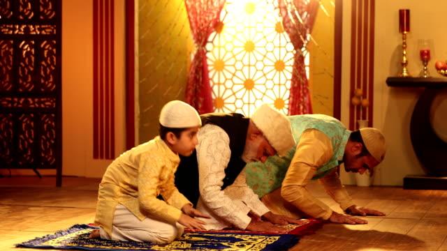 ms muslim multi generation family praying together at home during ramadan / delhi, india - praying stock videos & royalty-free footage