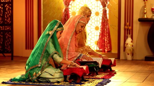 ms muslim multi generation family praying together at home during ramadan / delhi, india - koran stock videos & royalty-free footage