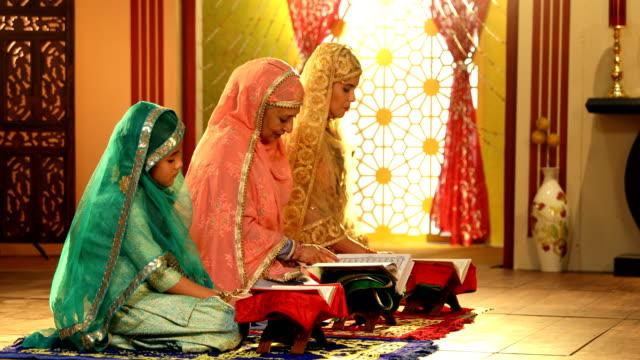 ms pan zi muslim multi generation family reading quran at home / delhi, india - koran stock videos & royalty-free footage