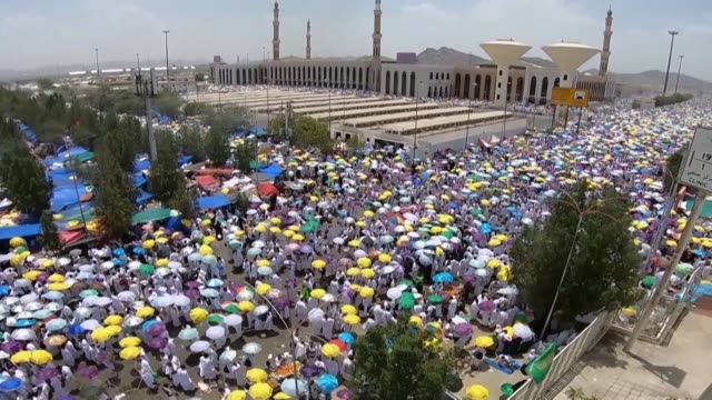 muslim pilgrim walk and pray in the rain near mount arafat also known as jabal al-rahma southeast of the saudi holy city of mecca as the climax of... - pilgrim stock videos & royalty-free footage
