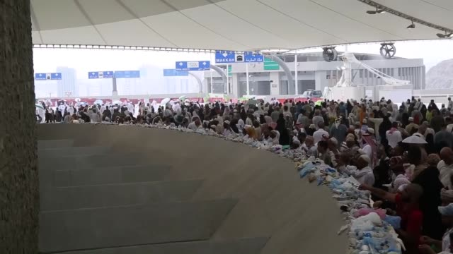 Muslim pilgrims arrive at alJamarat a series of three pillars representing the devil that the faithful pelt with stones to purge themselves of sin...