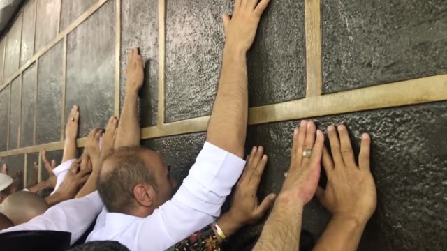 muslim pilgrims circle around the kaaba islam's holiest site located in the center of the masjid alharam in the holy city of mecca saudi arabia on... - al haram mosque stock videos and b-roll footage