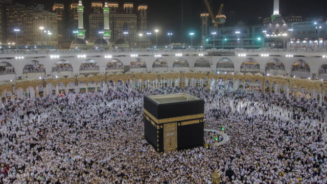 muslim pilgrims circumambulate the kaaba at masjidil haram in makkah, saudi arabia - mecca stock videos and b-roll footage