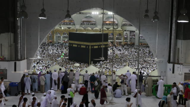 muslim pilgrims circumambulate the kaaba at masjidil haram in makkah, saudi arabia - koran stock videos and b-roll footage