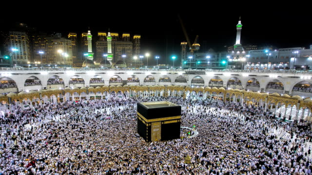 muslim pilgrims circumambulate the kaaba at masjidil haram in makkah, saudi arabia - eid mubarak stock videos & royalty-free footage
