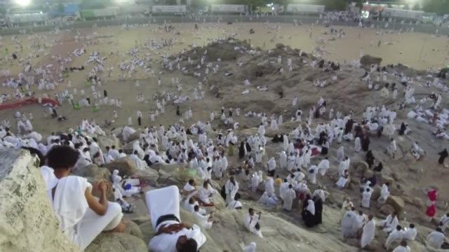 muslim pilgrims climb the jabal alnour to visit hira cave ahead of the start of the annual hajj pilgrimage in mecca saudi arabia on august 31 2017... - hajj stock videos & royalty-free footage