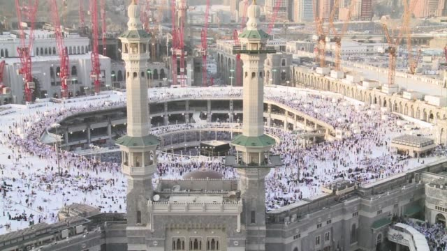 muslim pilgrims continue praying at meccas grand mosque home of the cube shaped kaaba or house of god - grand mosque stock videos and b-roll footage