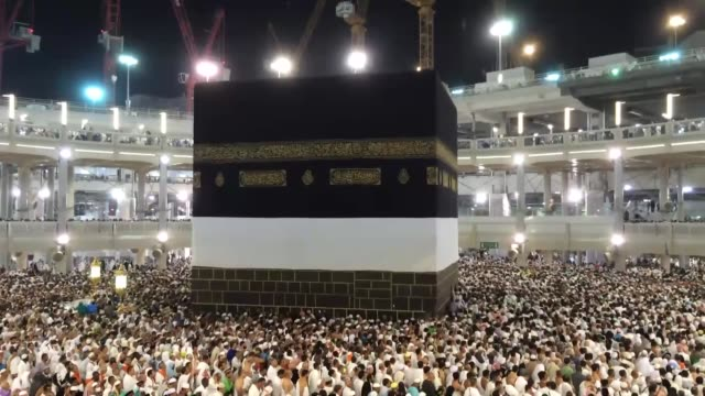 muslim pilgrims from all around the world arrive at masjid alharam to circle counterclockwise islam's holiest shrine the kaaba ahead of upcoming eid... - al haram mosque stock videos and b-roll footage