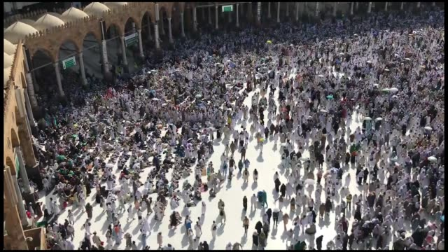 muslim pilgrims from all around the world circling around the kaaba islam's holiest site located in the center of the masjid alharam in mecca saudi... - hajj stock videos & royalty-free footage