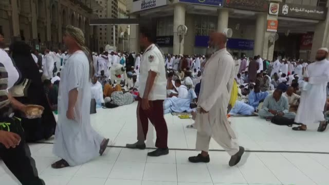 muslim pilgrims from all around the world circling around the kaaba islam's holiest site located in the center of the masjid alharam in mecca saudi... - grand mosque stock videos and b-roll footage