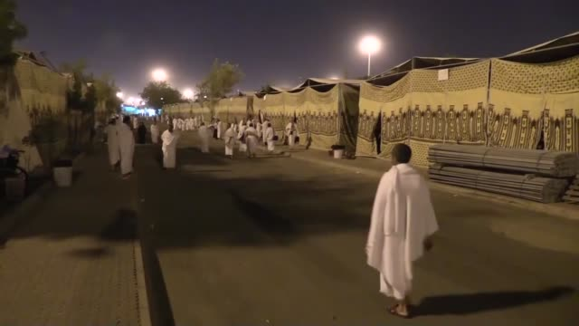 muslim pilgrims head to the mount arafat ahead of the hajj main ritual in mecca saudi arabia on october 02 2014 muslim pilgrims read the quran... - holy book stock videos and b-roll footage