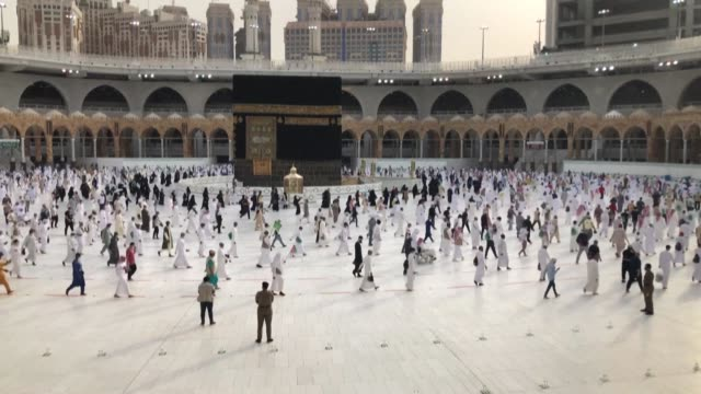 muslim pilgrims perform tawaf circumambulating the kaaba a black masonry cube in the centre of the grand mosque and islam's holiest shrine on the... - hajj stock videos & royalty-free footage