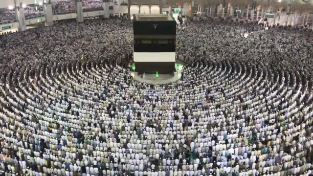 "Muslim pilgrims perform the ritual ""stoning of the devil"" at Jamarat and gather at the Kaaba Islam's holiest site located in the center of the Masjid..."