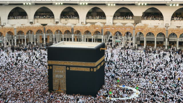 muslim pilgrims touring the holy kaaba in mecca in saudi arabia - mosque stock videos & royalty-free footage