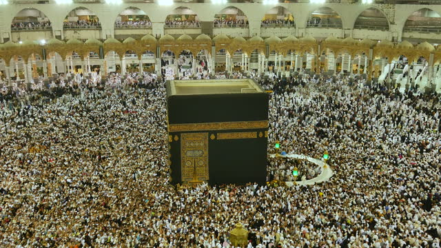muslim pilgrims touring the holy kaaba in mecca in saudi arabia - pilgrimage stock videos & royalty-free footage