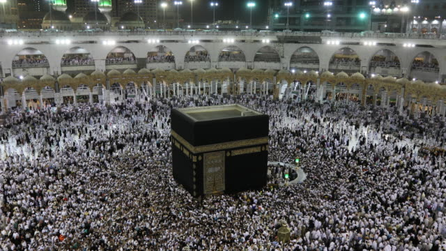 muslim pilgrims touring the holy kaaba in mecca in saudi arabia - mecca stock videos and b-roll footage